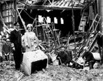 George VI and wife inspecting bombing damage during WWII